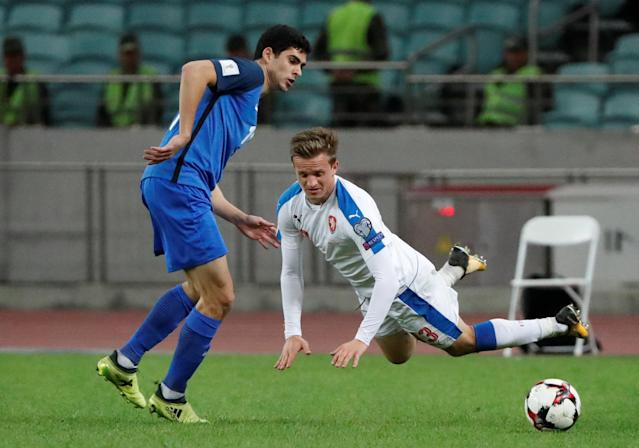 Soccer Football - 2018 World Cup Qualifications - Europe - Azerbaijan vs Czech Republic - Baku National Stadium, Baku, Azerbaijan - October 5, 2017 Azerbaijan's Ramil Sheydaev in action with Czech Republic's Jan Kopic REUTERS/Grigory Dukor