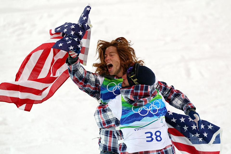 <p>Shaun White of the United States reacts with fellow American Scott Lago after White wins the gold medal and Lago the bronze in the Snowboard Men's Halfpipe final on day six of the Vancouver 2010 Winter Olympics at Cypress Snowboard & Ski-Cross Stadium on February 17, 2010 in Vancouver, Canada. White won the gold medal with a score in his previous run. (Photo by Cameron Spencer/Getty Images) </p>