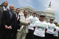 Representatives Jeff Denham, Mike Coffman, Joaquin Castro and Luis Gutierrez join a group of undocumented youths who want to serve the US in uniform but can't due to their immigration status, during a rally in front of the US Captiol May 20, 2014 (AFP Photo/Chip Somodevilla)