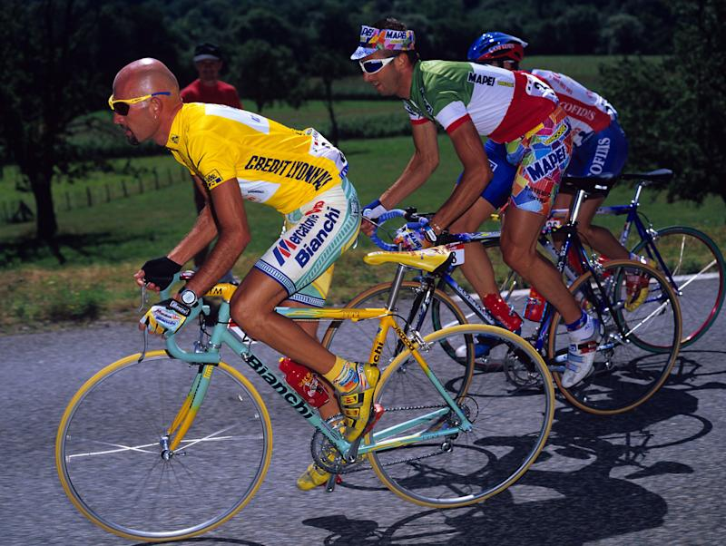 Race leader Marco Pantani (Mercatone Uno) rides ahead of compatriot and Italian road race champion Andrea Tafi (Mapei) on stage 18 of the 1998 Tour de France. Pantani's using an earlier 'Pirate' design on a Selle Italia Flite saddle, similar to the design of the Flite Classic saddle that celebrated his 1998 Giro-Tour double featured here