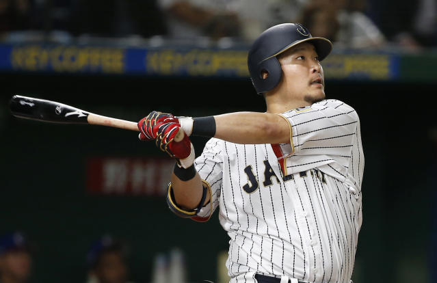 FILE - In this March 7, 2017, file photo, Japan's Yoshitomo Tsutsugo hits a two-run shot against Cuba's pitcher Jonder Martinez in the seventh inning of their first round game of the World Baseball Classic at Tokyo Dome in Tokyo. Tsutsugo has been made available to major league teams through the posting process by Yokohaha of Japan's Central League. Major league clubs have until 5 p.m. EST on Dec. 19, 2019, to bid for Tsutsugo, who turns 28 on Nov. 26. (AP Photo/Shizuo Kambayashi, File)