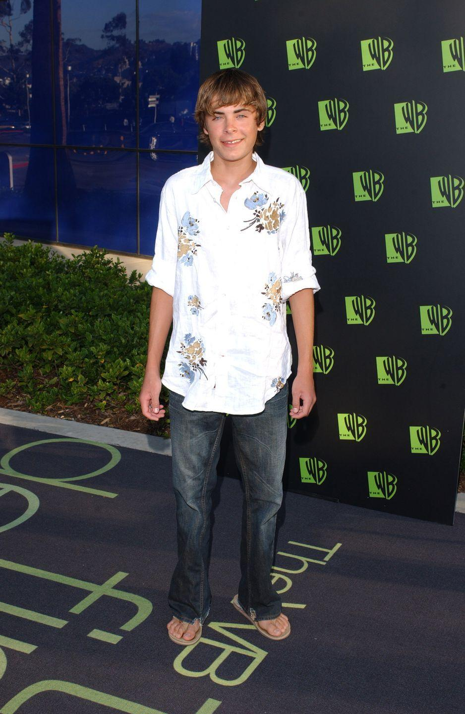 <p>Not yet a heartthrob, Zac Efron arrived at the WB's All-Star Summer Party in a flower-adorned linen shirt that, shockingly, was not paired with a puka shell necklace.</p>