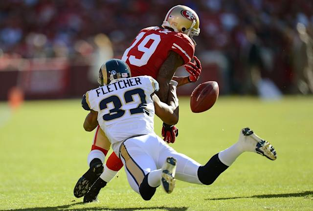 SAN FRANCISCO, CA - NOVEMBER 11: Ted Ginn Jr #19 of the San Francisco 49ers returning a kickoff has the ball stripped away by Bradley Fletcher #32 of the St. Louis Rams during the first quarter of an NFL football game at Candlestick Park on November 11, 2012 in San Francisco, California. The 49ers recovered the the ball on the play. (Photo by Thearon W. Henderson/Getty Images)