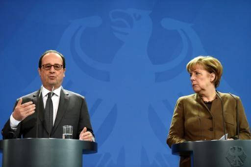 Merkel, Hollande want to extend Russia sanctions over Ukraine