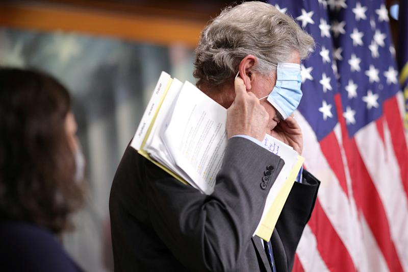 Rep. Frank Pallone (D-NJ) adjusts his face mask after delivering remarks at a news conference on the presidential administration's response to and House Democrats' plan for coronavirus disease (COVID-19) testing, on Capitol Hill in Washington, U.S., May 27, 2020. REUTERS/Tom Brenner TPX IMAGES OF THE DAY