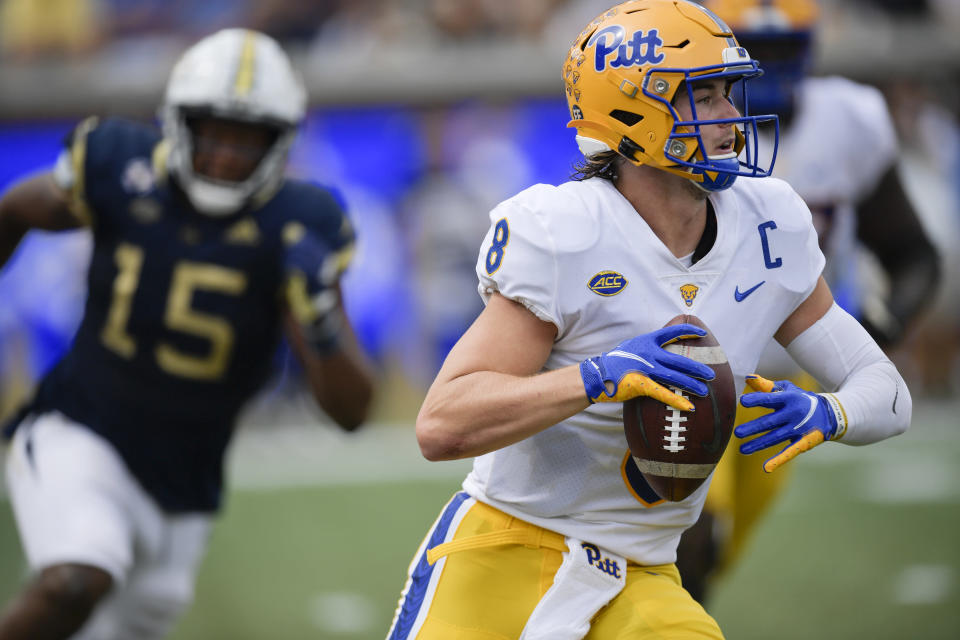 Pittsburgh quarterback Kenny Pickett (8) runs out of the pocket against Georgia Tech during the first half of an NCAA college football game, Saturday, Oct. 2, 2021, in Atlanta. (AP Photo/Mike Stewart)