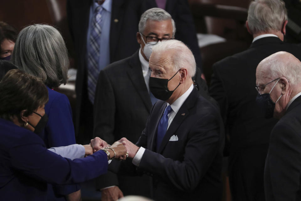 President Joe Biden speaks to members of Congress after speaking to a joint session of Congress Wednesday, April 28, 2021, in the House Chamber at the U.S. Capitol in Washington. (Michael Reynolds/Pool via AP)
