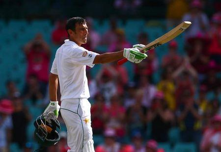 Pakistan's Younis Khan celebrates after reaching his century.      REUTERS/David Gray