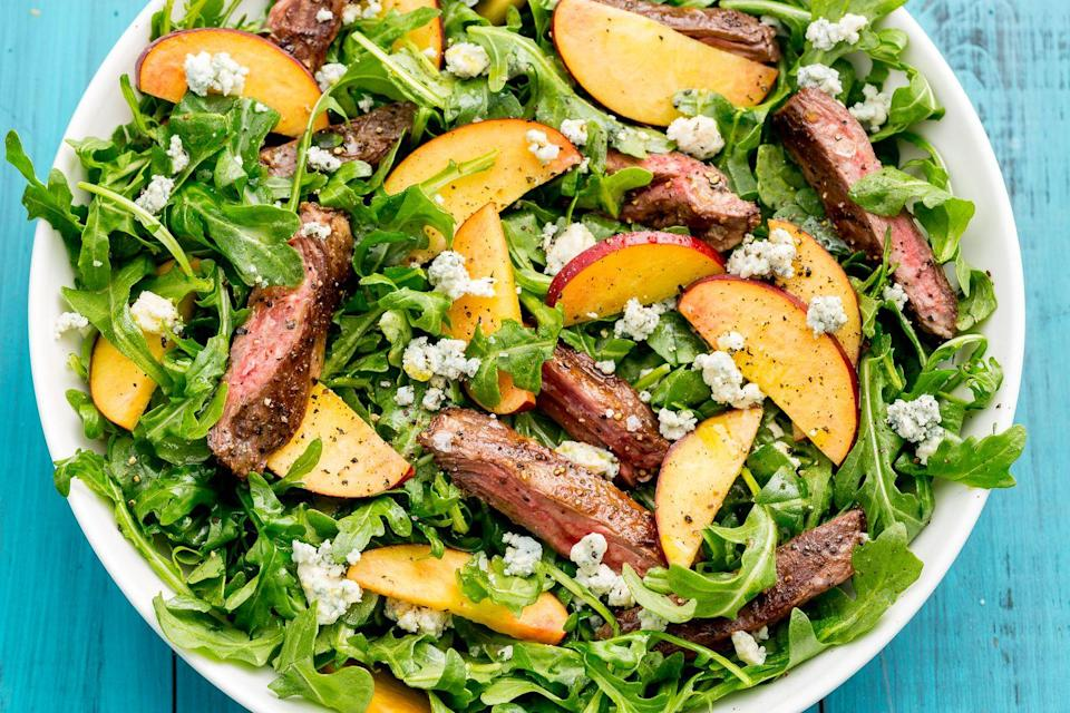 """<p>Peppery arugula is the perfect vessel for this savory-sweet combo.</p><p>Get the recipe from <a href=""""https://www.delish.com/cooking/recipe-ideas/recipes/a47340/balsamic-grilled-steak-salad-with-peaches-recipe/"""" rel=""""nofollow noopener"""" target=""""_blank"""" data-ylk=""""slk:Delish"""" class=""""link rapid-noclick-resp"""">Delish</a>.</p>"""