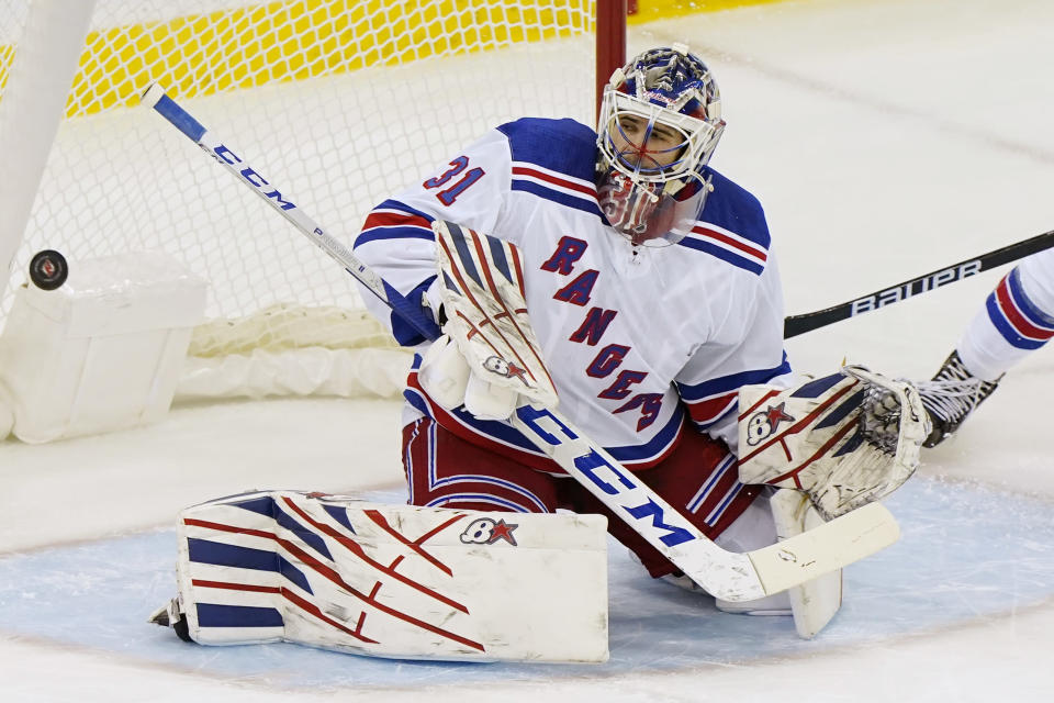 A goal scored by New Jersey Devils center Jack Hughes (86) goes into the net behind New York Rangers goaltender Igor Shesterkin (31) during the first period of an NHL hockey game between the New Jersey Devils and the New York Rangers, Thursday, March 4, 2021, in Newark, N.J. (AP Photo/Kathy Willens)