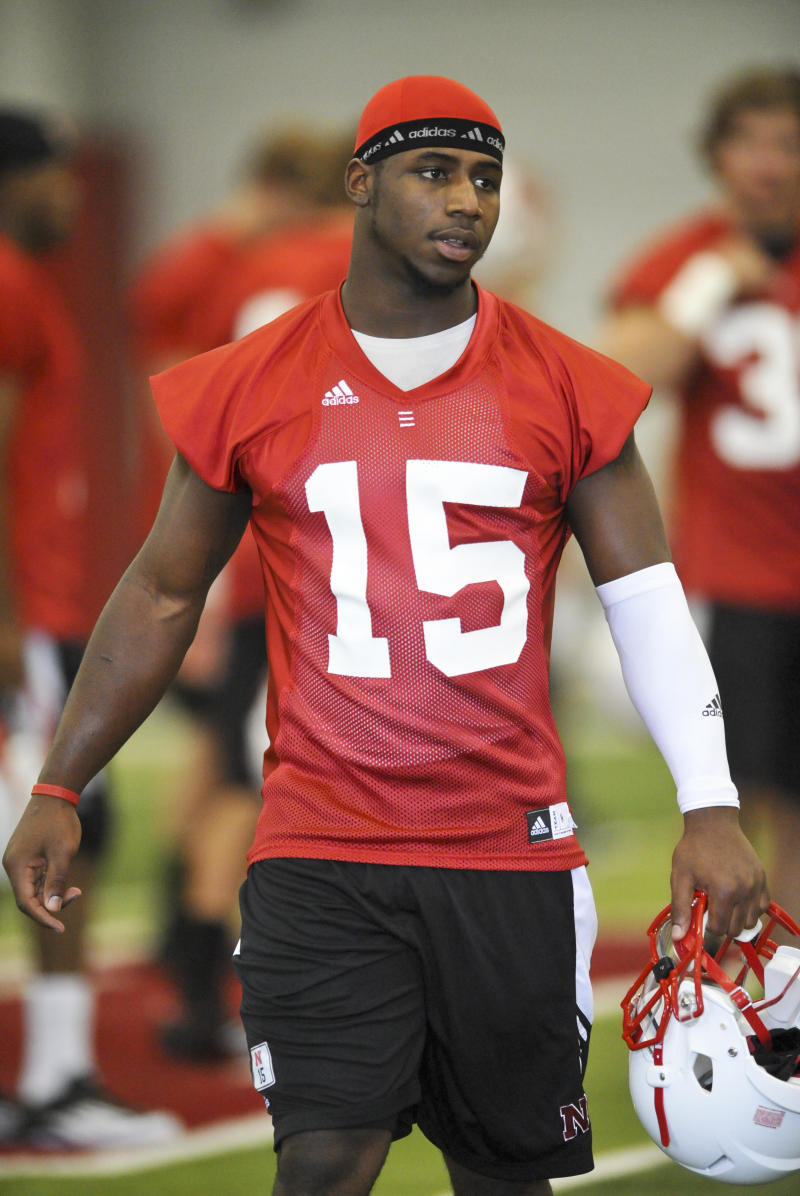 FILE - In this Aug. 6, 2011 file photo,  Nebraska cornerback Alfonzo Dennard walks across the field on the first day of NCAA college football practice, in Lincoln, Neb. Dennard. Nebraska's outgoing star cornerback, has been arrested following a disturbance early Saturday, April 21, 2012, outside a Lincoln bar. Police Capt. Jason Stille said Dennard, 22, originally from Rochelle, Ga., was arrested on suspicion of assault of a police officer, third-degree assault and resisting arrest. He was held Saturday in the Lancaster County jail.   (AP Photo/Dave Weaver, File)