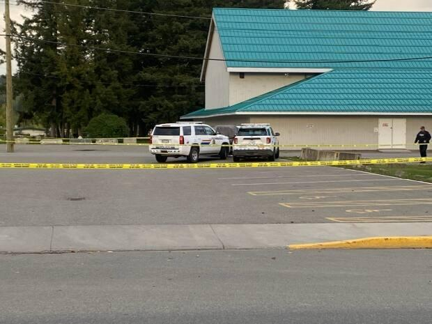 Police tape surrounds the parking lot behind a seniors centre in downtown Quesnel.  (Submitted by Kevin Toews - image credit)
