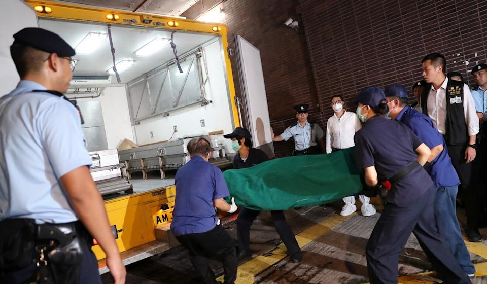 The body of 53-year-old victim Chan Wai-man is removed from a University of Hong Kong building on August 28, 2018. K. Y. Cheng