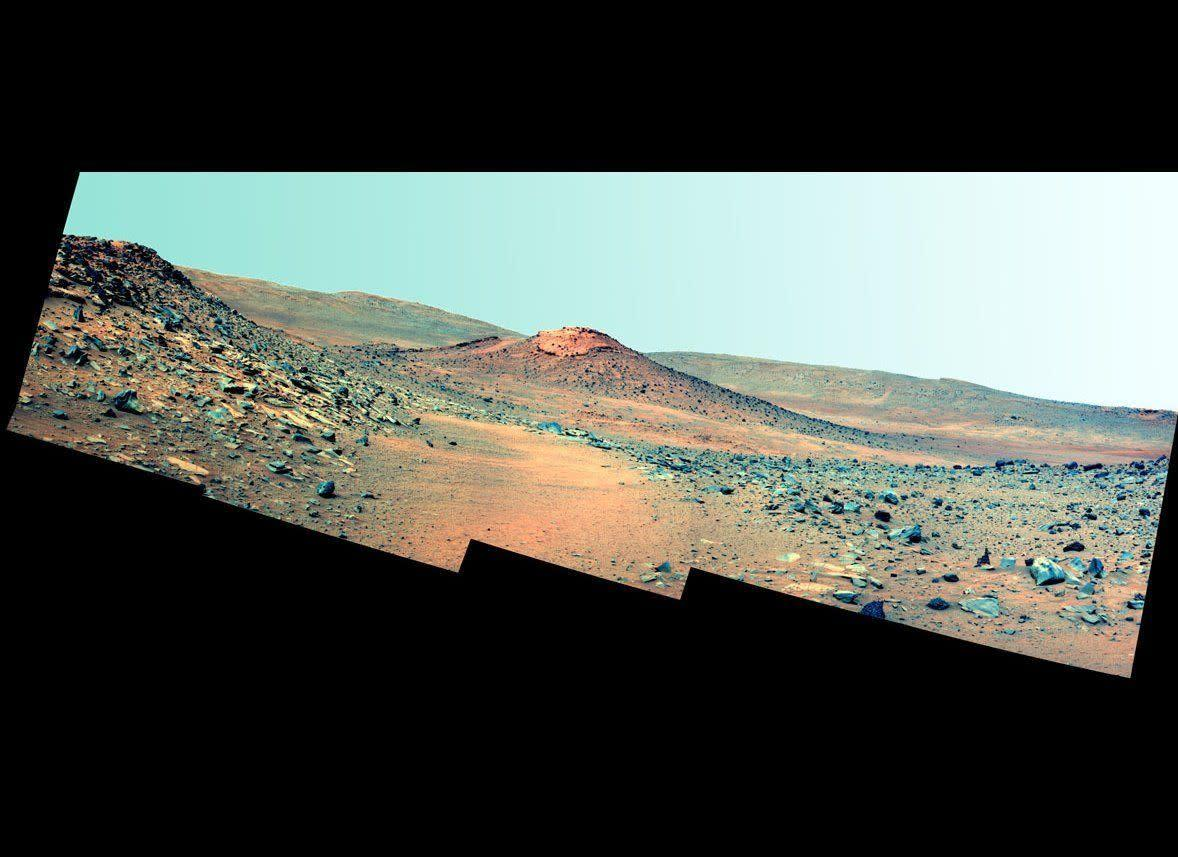 """This Spirit Pancam false-color postcard, taken on mission sol 2114 (January 4, 2010) shows a volcanic hill called Von Braun, which could be the rover's next exploration target once the rover emerges from its long winter hibernation. <em>From """"Postcards from Mars"""" by Jim Bell; Photo credit: NASA/JPL/Cornell University </em>"""
