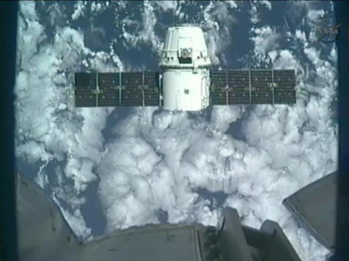 This image provided by NASA-TV shows the SpaceX Dragon commercial cargo craft taken from Canadarm2's video camera as Dragon approaches the International Space Station, Friday, May 25, 2012. In foreground is a portion of Canadarm2. Expedition 31 Flight Engineers Don Pettit and Andre Kuipers will use the Canadarm2 robotic arm to grapple the supply ship Friday morning with the berthing to the Earth-facing side of the station's Harmony node following. Dragon is scheduled to spend about a week docked with the station before returning to Earth on May 31 for retrieval. (AP Photo/NASA)
