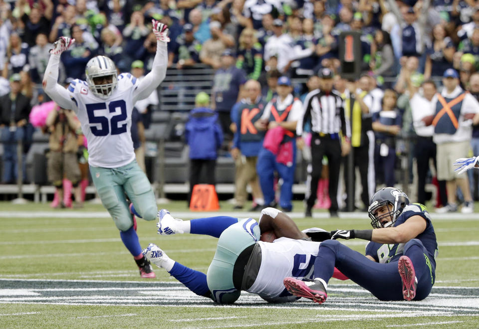 FILE - In this Oct. 12, 2014, file photo, Dallas Cowboys middle linebacker Rolando McClain, center, comes down with an interception on a pass intended for Seattle Seahawks tight end Luke Willson, right, as Cowboys' Justin Durant (52) celebrates late in the second half of an NFL football game in Seattle. The Cowboys beat the Seahawks 30-23. A double-digit deficit is no longer the death knell it used to be in the NFL. (AP Photo/Elaine Thompson, File)
