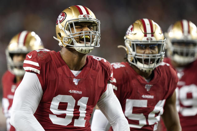 San Francisco 49ers defensive end Arik Armstead (91) celebrates with middle linebacker Fred Warner (54) during the first half of an NFL football game against the Green Bay Packers in Santa Clara, Calif., Sunday, Nov. 24, 2019. (AP Photo/Tony Avelar)