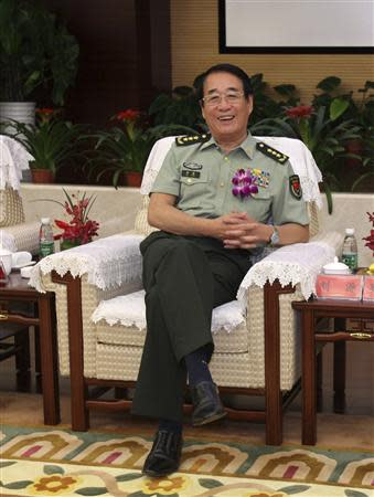 Liu Yuan, the People's Liberation Army (PLA) General Logistics Department political commissar and also the son of former China's Chairman Liu Shaoqi, smiles at the opening ceremony of PLA General Hospital Hainan Branch, in Sanya, Hainan, in this June 9, 2012 file photo. REUTERS/Stringer