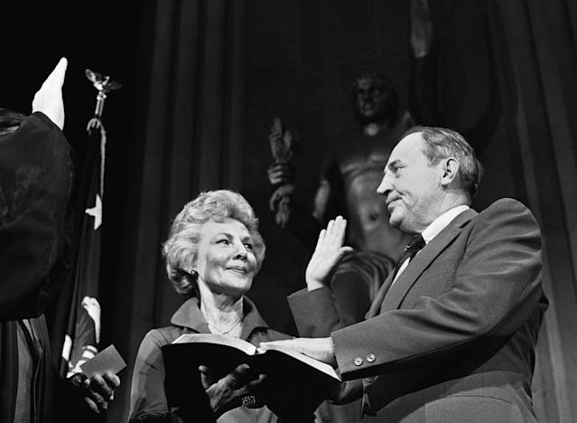 <p>William Saxbe takes the oath of as he is sworn in as the nation's 78th attorney general in Washington on Friday, Jan. 4, 1974. His wife, Ardath, takes part in the ceremony. Saxbe replaced Elliot Richardson, who resigned in the wake of the firing of Archibald Cox. (Photo: Henry Burroughs/AP) </p>