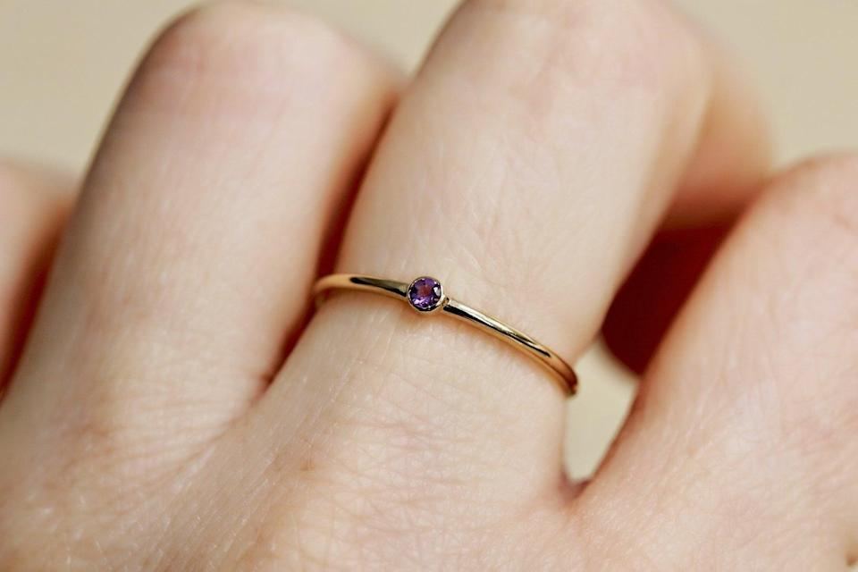 """<h2>February: Amethyst<br></h2><br><strong>The Signs: Aquarius & Pisces<br></strong><br>""""In Greek myth,"""" explains Cally Oldershaw in """"Guide to Gems"""", """"amethyst was rock crystal dyed purple by Dionysus, the god of wine and revelry."""" The stone has long been associated with sobriety<em> — amethustos</em> is the Greek word for """"sober."""" This clear-headed stone is the perfect present for the introspective February-born Pisces or visionary Aquarius.<br><br><strong>Liesel Love</strong> 14K Gold Tiny Amethyst Ring, $, available at <a href=""""https://go.skimresources.com/?id=30283X879131&url=https%3A%2F%2Fwww.etsy.com%2Flisting%2F687673555%2F14k-gold-tiny-amethyst-ring-purple-stone"""" rel=""""nofollow noopener"""" target=""""_blank"""" data-ylk=""""slk:Etsy"""" class=""""link rapid-noclick-resp"""">Etsy</a>"""