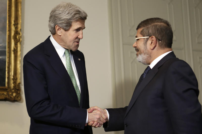 U.S. Secretary of State John Kerry, left, shakes hands with Egyptian President Mohamed Morsi at the Presidential Palace in Cairo, Egypt on Sunday, March 3, 2013. U.S. Secretary of State John Kerry met with Egypt's president Sunday, wrapping up a visit to the deeply divided country with an appeal for unity and reform. The U.S. is deeply concerned that continued instability in Egypt will have broader consequences in a region already rocked by unrest. (AP Photo/Jacquelyn Martin, Pool)