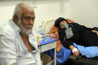 Coronavirus patients receive treatment at a hospital in Najaf, Iraq, Wednesday, July 14, 2021. Infections in the country have surged to record highs amid a third wave spurred by the more aggressive Delta variant, and long-neglected hospitals suffering the effects of decades of war are overwhelmed with severely ill patients. (AP Photo/Anmar Khalil)