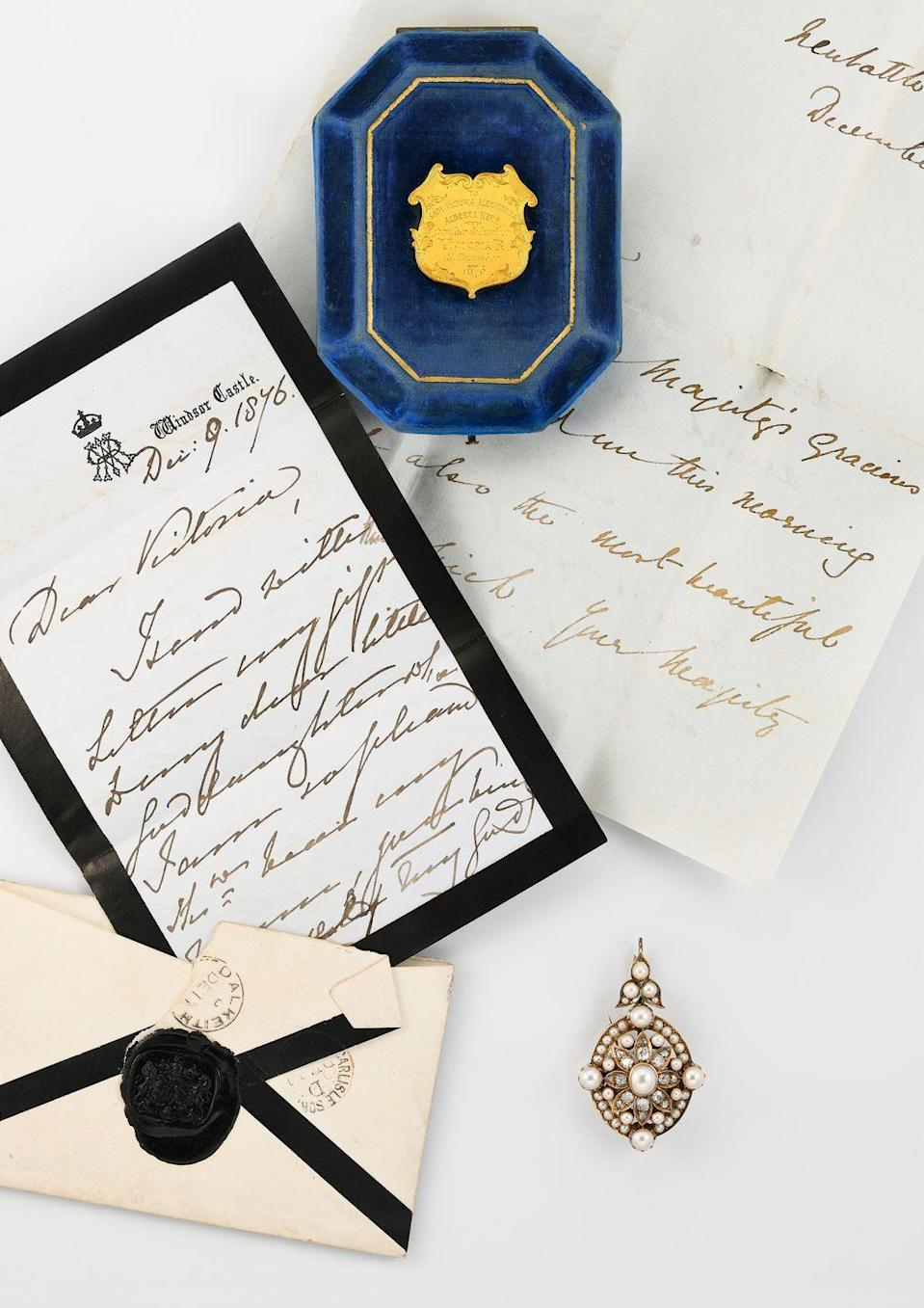 """<p>A collection of precious jewellery gifted by Queen Victoria to two of her god-daughters will go up for sale this month. The selection of pieces that once belonged to Lady Victoria Douglas-Scott, daughter of the Queen's Mistress of the Robes, the Duchess of Buccleuch, includes a gold locket, set with emeralds and diamonds in the shape of the Queen's insignia, gifted to celebrate her marriage in February 1865 to Henry Kerr, 9th Marquess of Lothian. Also for sale is a beautiful pearl and diamond brooch-pendant, offered to Lady Victoria's daughter by the Queen in December 1876 as a christening gift, accompanied by a letter from the monarch to mark the occasion. </p><p>The Jewellery, Silver, Watches and Wine sale will take place on 5 November at <a href=""""https://www.cheffins.co.uk/fine-art/catalogue-view,the-jewellery-silver-watches-sale_174.htm"""" rel=""""nofollow noopener"""" target=""""_blank"""" data-ylk=""""slk:Cheffins"""" class=""""link rapid-noclick-resp"""">Cheffins</a>, Cambridge.</p>"""