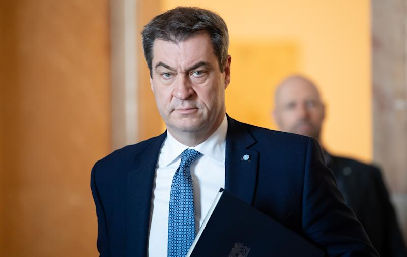 19 March 2020, Bavaria, Munich: Markus Söder (CSU), Prime Minister of Bavaria, comes to the Bavarian parliament for a plenary session. The topic of the session is a government declaration including debates on the coronavirus crisis in Bavaria. Photo: Sven Hoppe/dpa (Photo by Sven Hoppe/picture alliance via Getty Images)