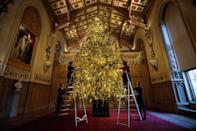 """<p>According to the Queen's former personal chef, <a href=""""http://www.goodhousekeeping.com/holidays/christmas-ideas/a42015/how-the-royal-family-celebrates-christmas/"""" rel=""""nofollow noopener"""" target=""""_blank"""" data-ylk=""""slk:Darren McGrady"""" class=""""link rapid-noclick-resp"""">Darren McGrady</a>, """"the Royal Family has a large Christmas tree and a large silver artificial tree in the dining room, which is about 30 years old.""""</p>"""