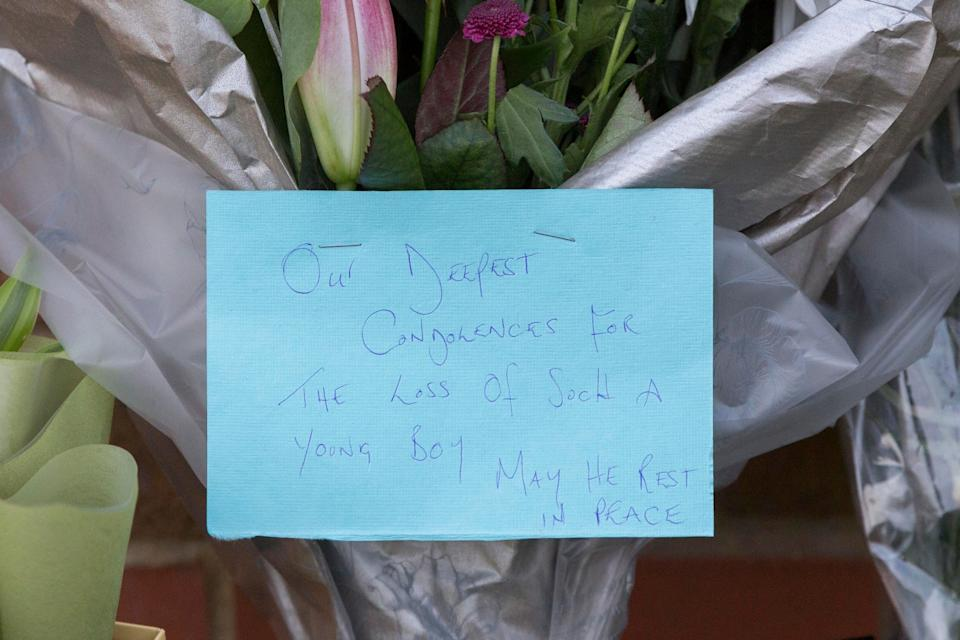 One of the floral tributes left at the scene (PA)