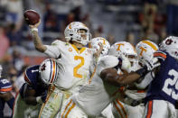 Tennessee quarterback Jarrett Guarantano (2) is hit by Auburn defensive end Big Kat Bryant as he throws the ball during the first half of an NCAA college football game Saturday, Nov. 21, 2020, in Auburn, Ala. (AP Photo/Butch Dill)