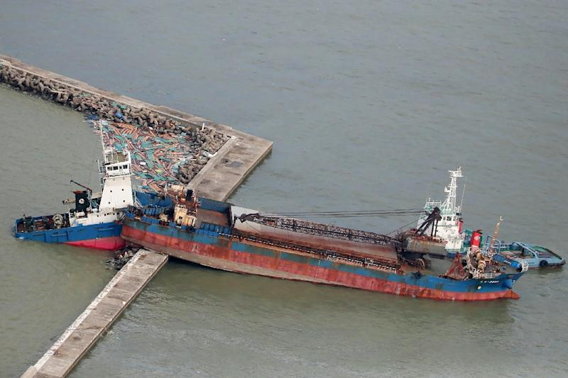 More than 200-kilometre-an-hour winds caused havoc in the seas around Japan, sending this ship crashing into a breakwater (AFP Photo/JIJI PRESS)