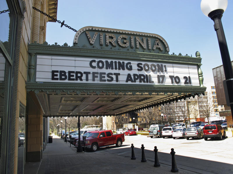 This April 5, 2013 photo shows the marquee at the Virginia Theater in Champaign, Ill., announcing the upcoming Ebertfest film festival running April 17-21. Through his television shows, movies reviews and essays, movie critic Roger Ebert belonged to the world beyond nearby Urbana, Ill. One part of Ebert's life that got little attention as the nation mourned his sudden death April 4 was how much he meant to this university town where he grew up. (AP Photo/David Mercer)