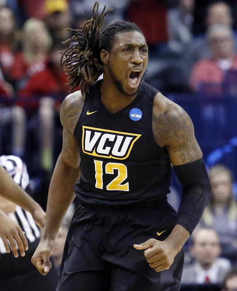 FILE - In this March 20, 2016, file photo, VCU forward Mo Alie-Cox (12) shouts in the first half of a second-round men's college basketball game against Oklahoma in the NCAA Tournament in Oklahoma City. The agent for former VCU forward Mo Alie-Cox says his client has agreed to terms with the NFL's Indianapolis Colts. Joe Flanagan said Thursday, April 20, 2017,, the 6-foot-7, 250-pound Alie-Cox will fly to Indianapolis to sign the contract on Friday.  (AP Photo/Sue Ogrocki, File)