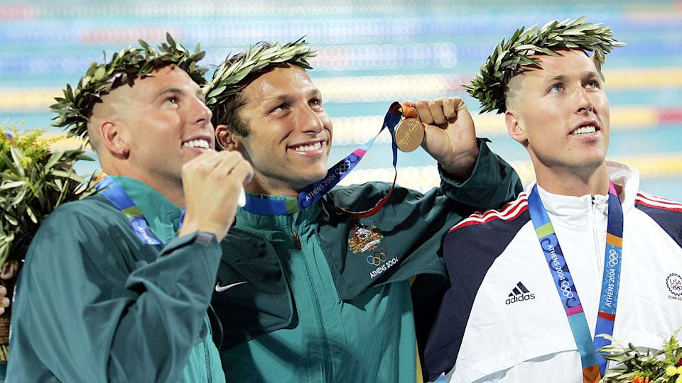 Pictured right, Klete Keller poses with his 400m freestyle bronze from at the 2004 Athens Olympic Games.