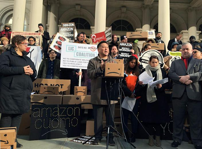In this Dec. 12, 2018, file photo, New York State Assemblyman Ron Kim, center, speaks at a rally opposing New York's deal with Amazon on the steps of New York's City Hall.