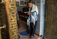 Morocco is home to North Africa's largest Jewish community, which has been there since ancient times; this October 13, 2017 photograph shows a ceremony in a synagogue in Marrakesh