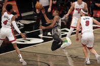 Brooklyn Nets forward Kevin Durant shoots as he falls to the floor after being fouled by Miami Heat forward Kelly Olynyk (9) during the first half of an NBA basketball game Monday, Jan. 25, 2021, in New York. (AP Photo/Adam Hunger)