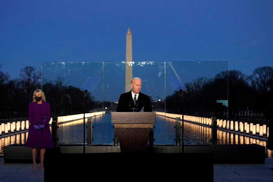 <p>President-elect Joe Biden speaks during a Covid-19 memorial, with lights placed around the Lincoln Memorial Reflecting Pool, Tuesday, Jan. 19, 2021, in Washington</p> (AP)