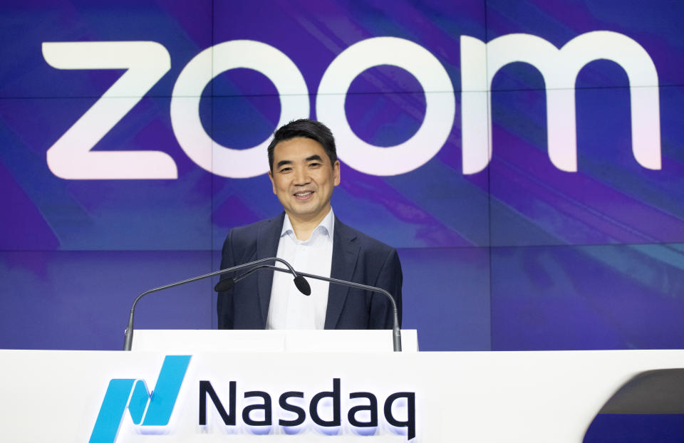 FILE - In this April 18, 2019 file photo, Zoom CEO Eric Yuan attends the opening bell at Nasdaq as his company holds its IPO in New York.  Millions of people are now working from home as part of the intensifying fight against the coronavirus outbreak. Beside relying on Zoom, the video conference service, more frequently as part of their jobs, more people are also tapping it to hold virtual happy hours with friends and family banned from gathering in public places.  (AP Photo/Mark Lennihan, File)