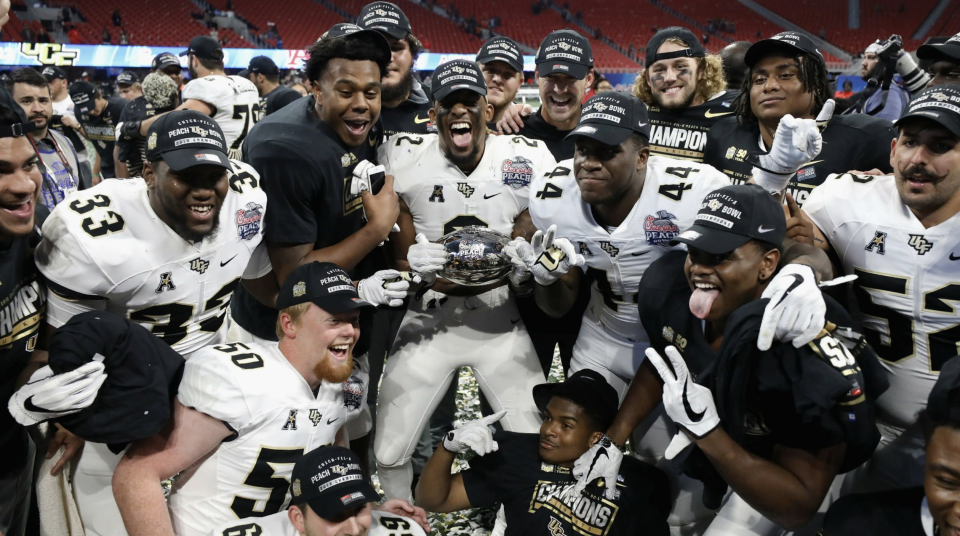 The UCF administration is putting its money where its mouth is, paying Scott Frost's coaching staff their contract bonuses for winning a national championship. (Getty)