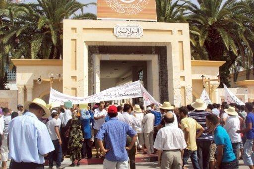Local residents block the entrance to the Sidi Bouzid provincial government headquarters during a protest against the Islamist-led government. Police fired tear gas and rubber bullets to disperse a second anti-government protest in the central Tunisian town of Sidi Bouzid, birthplace of last year's revolution