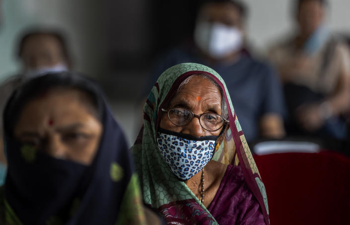 Elderly Indians wait to receive the COVID-19 vaccine at a private hospital in Gauhati, India, Thursday, March 4, 2021. The COVID-19 vaccination drive for senior citizens and those above 45 years of age with comorbidities began in government and designated private hospitals in Gujarat on Monday along with the rest of the country. (AP Photo/Anupam Nath)