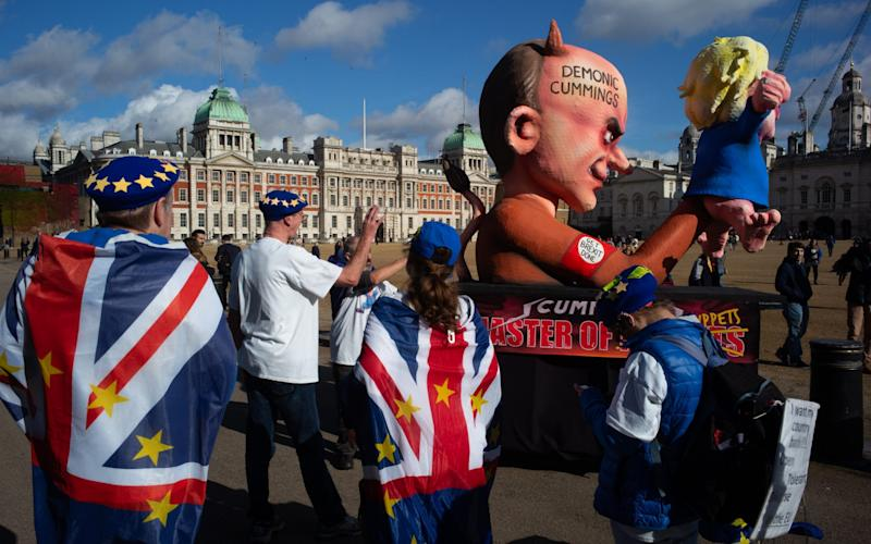 An effigy of Boris Jonson and Dominic Cummings is pulled through Westminster during the anti-Brexit march - Jeff Moore 07870209766
