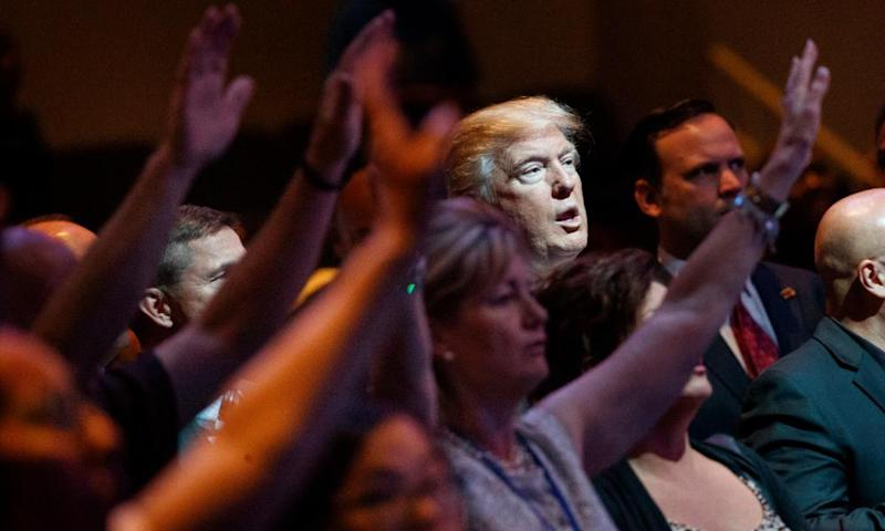 Donald Trump stands during a service at the International Church of Las Vegas in October 2016.