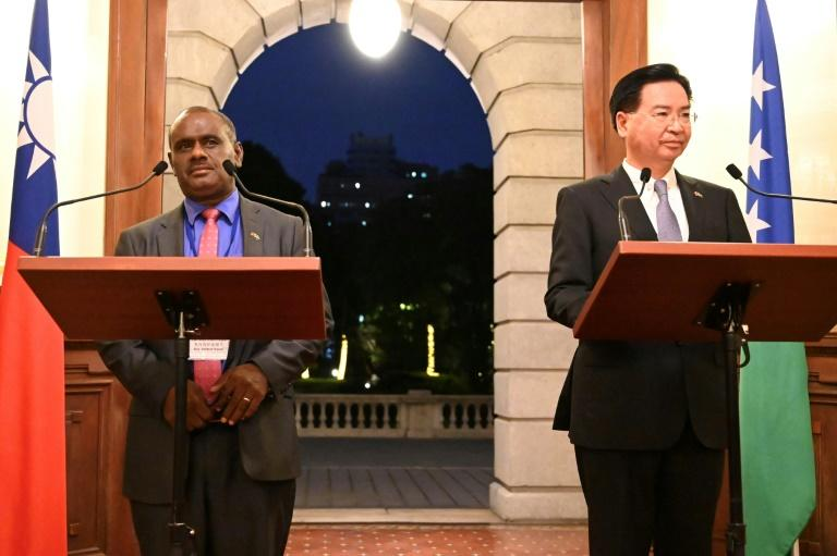 Taiwan's Foreign Minister Joseph Wu (R) took part in a press conference with Solomon Islands Foreign Minister Jeremiah Manele (L) in Taipei on September 9, 2019 -- a week later, Honiara has switched its diplomatic allegiance to Beijing