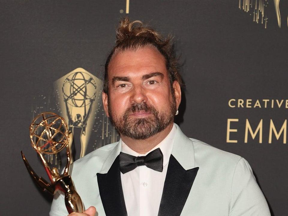 Marc Pilcher poses with the award for Outstanding Period And/Or Character Hairstyling for 'Bridgerton' at the 2021 Emmys (Getty Images)