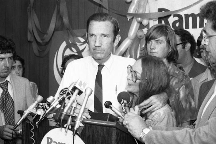 FILE - In this Wednesday, Sept. 14, 1976 file photo, Ramsey Clark, Democratic candidate for the U.S. Senate, center, speaks at Lincoln Center in New York. Ramsey Clark, the attorney general in the Johnson administration who became an outspoken activist for unpopular causes and a harsh critic of U.S. policy, has died, Friday, April 9, 2021. He was 93. (AP Photo/Dave Pickoff, File)