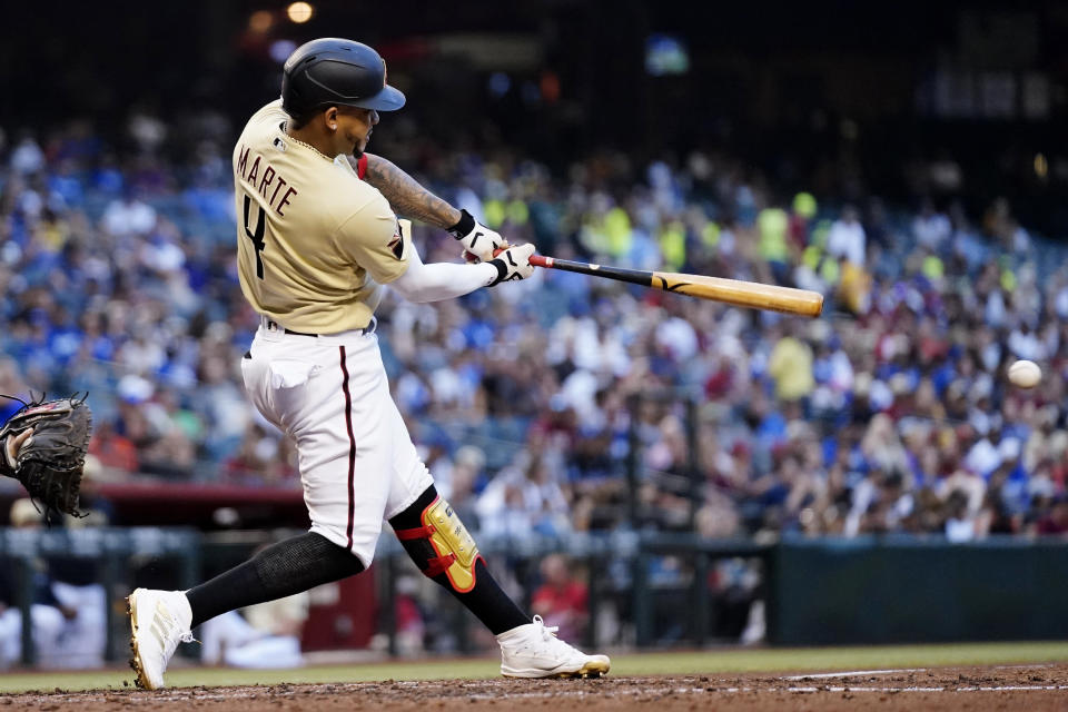 Arizona Diamondbacks' Ketel Marte connects for a single against the Los Angeles Dodgers during the third inning of a baseball game Saturday, Sept. 25, 2021, in Phoenix. (AP Photo/Ross D. Franklin)