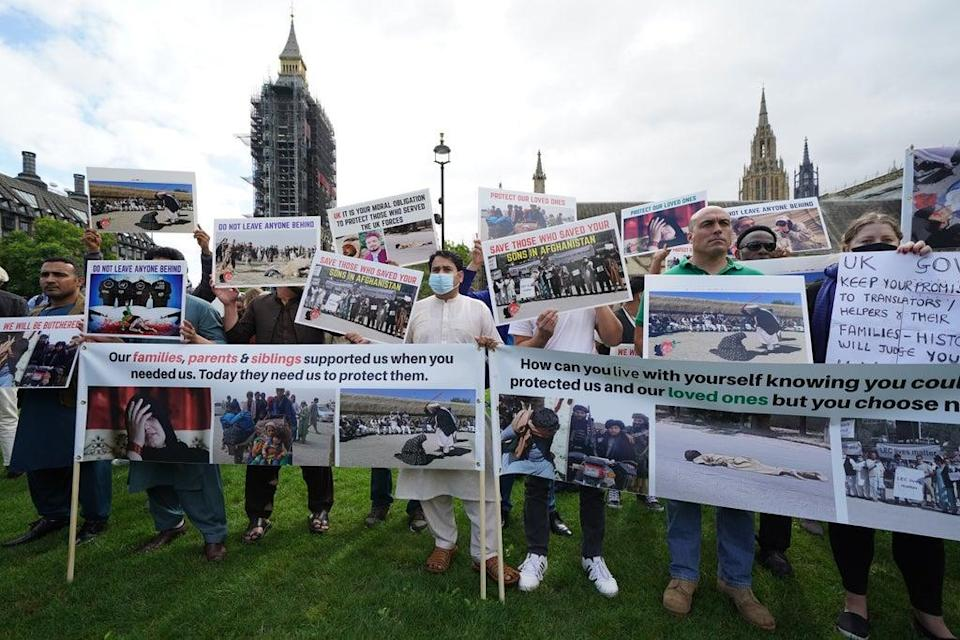 Former Afghan interpreters and veterans protest in Parliament Square (Kirsty O'Connor/PA) (PA Wire)